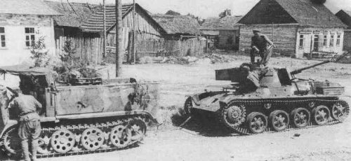 Black and white photograph of a 41M Toldi II being towed by a half-track